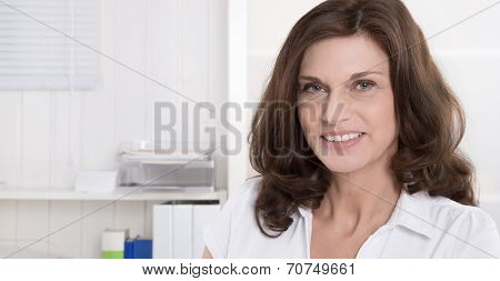 Portrait Of Pretty Older Woman On White Background.