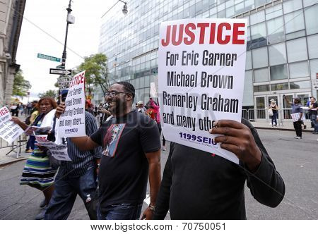 Justice for Eric Garner, etc. signs