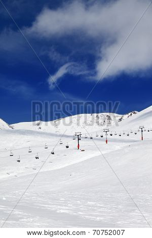 Chair-lift And Ski Slope At Sun Day