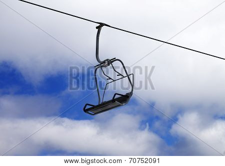 Chair-lift And Cloudy Sky