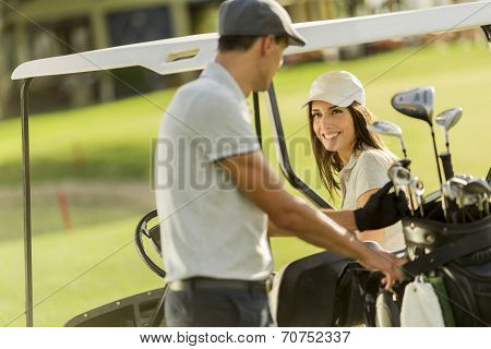 Young Couple At Golf Cart