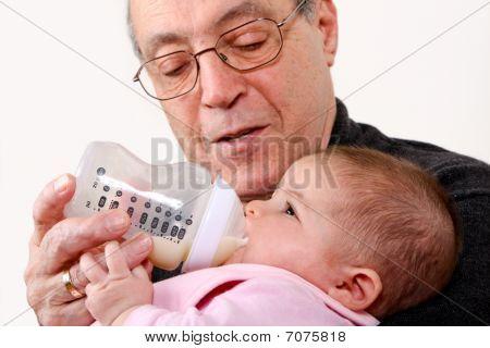 Grandpa Bottle Feeding Baby Girl