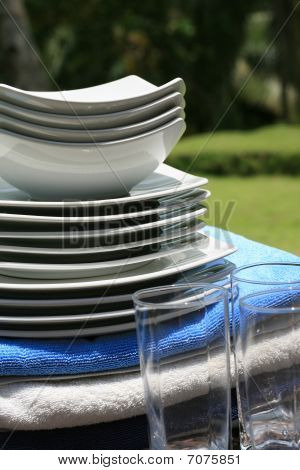 Set Of Ceramic Plates And Glassware At Resort