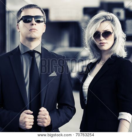 Young fashion business couple on the city street