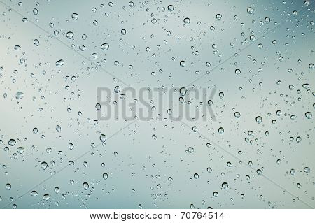 Drops Of Rain Pour Down On The Glass