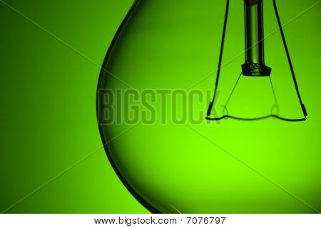 Detail Of Light Bulb On Green Background