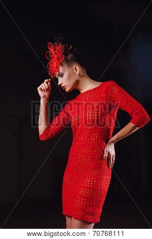Girl In A Red Lacy Dress On Black Background.