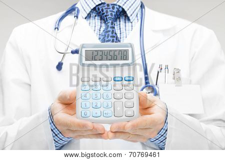 Doctor Holdling In His Hand Calculator - Studio Shoot