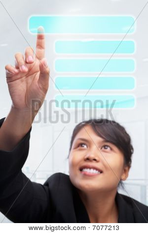 Young Asian Businesswoman Pointing Her Index Finger Options In See Through Touch Screen