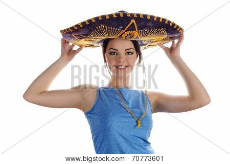 Young Smiling Girl Trying On Mexican Sombrero. Portrait On White Background