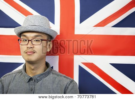 Portrait of a mid adult man against British flag