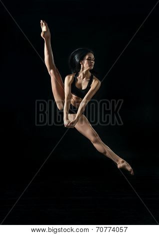 Young Ballet Dancer Dancing On black Background