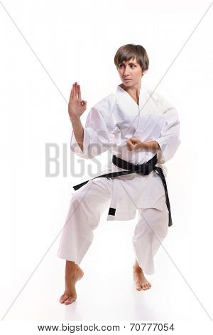 fighting karate girl, young woman with black belts - champions of the world, over white background studio shot