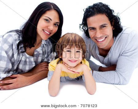 Cheerful Parents With Their Son Lying On The Floor