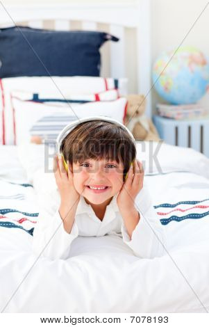 Cheerful Little Boy Listening Music With Headphones On