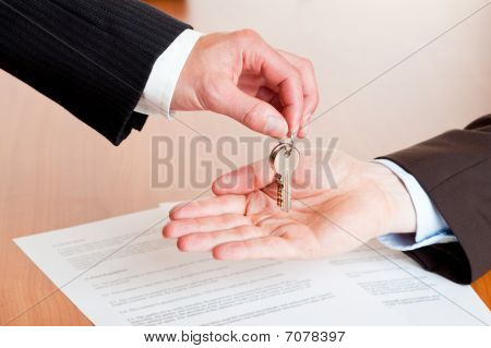Handing Over House Or Car Keys After Signing Of Contract