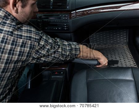 Dusting Car With Vacuum Cleaner