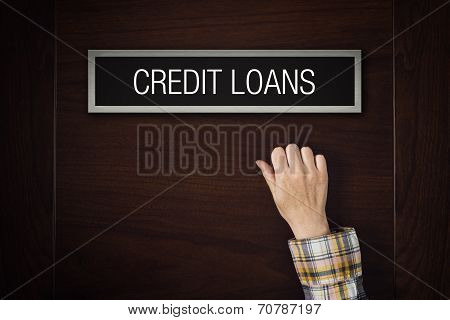 Hand Is Knocking On Credit Loans Door