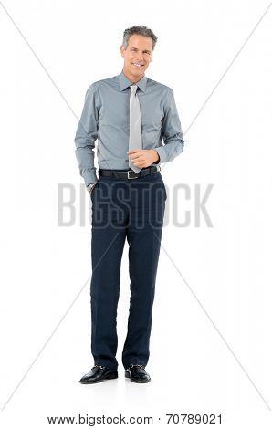Portrait Of Confident Mature Businessman Standing Isolated On White Background