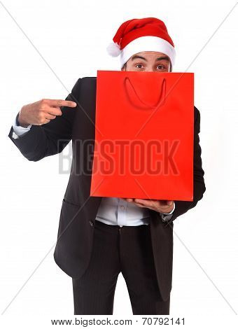 Funny Man Wearing Santa Hat Holding Red Shopping Bag