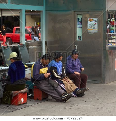 Shoeblacks in Ambato, Ecuador
