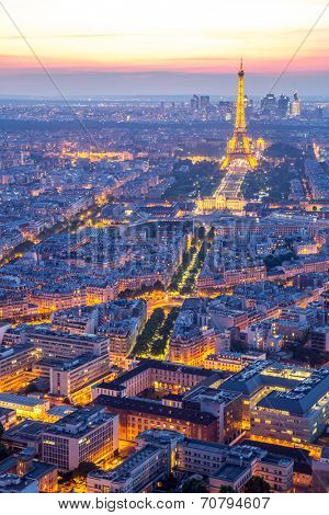 Paris - Jun 19: Aerial view of Eiffel Tower Light and Beam Performance Show at Dusk on Jun 19, 2014. Eiffel Tower is the highest monument in France use 20,000 light bulbs in the show.