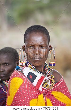 BISIL, KENYA-DECEMBER 7 2010:Unidentified Maasai women in full tribal garb in the village of Bisil in Southern Kenya