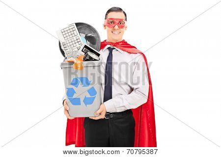 Male superhero recycling his old stuff in a recycle bin isolated on white background
