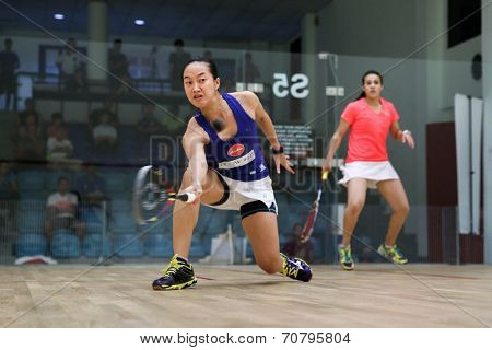AUGUST 19, 2014 - KUALA LUMPUR, MALAYSIA: Low Wee Wern of Malaysia (blue) hits a return from front court while playing Heba El Torky of Egypt in the CIMB Malaysian Open Squash Championship 2014.