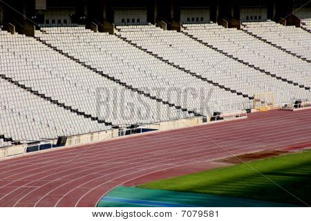 Rows Of Seats In Stadium And Track And Field Lane