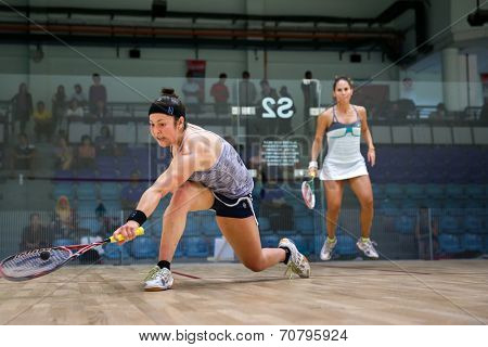 AUGUST 19, 2014 - KUALA LUMPUR, MALAYSIA: Amanda Sobhy of USA (blue shorts) plays Samantha Teran of Mexico in a match in the CIMB Malaysian Open Squash Championship 2014.