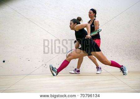 AUGUST 19, 2014 - KUALA LUMPUR, MALAYSIA: Delia Arnold of Malaysia hits a return at front court while playing Alison Waters of England (red skirt) in the CIMB Malaysian Open Squash Championship 2014.