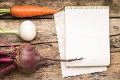 stock photo of recipe card  - Empty Recipe Card on Wooden Rustic Background with Fresh Vegetables - JPG