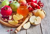 stock photo of pomegranate  - Pomegranate apple and honey traditional food of jewish New Year celebration Rosh Hashana - JPG