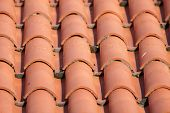 stock photo of red roof tile  - Construction detail of a red tile roof - JPG