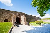 foto of blast-furnace  - The wall of Citadelle de Dinant with arch door and two blast - JPG