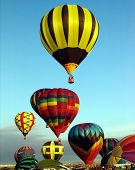 stock photo of lifting-off  - Balloons taking off during a mass lift off event - JPG