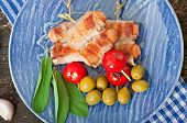 foto of bacon strips  - Grilled sausages wrapped in strips of bacon with tomatoes and sage leaves - JPG