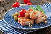 pic of bacon strips  - Grilled sausages wrapped in strips of bacon with tomatoes and sage leaves  - JPG