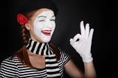 image of clown rose  - Portrait of a happy mime comedian showing OK on black background - JPG