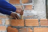 stock photo of bricklayer  - Workers were bricklayer at wall in houses - JPG