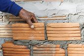 picture of bricklayer  - Workers were bricklayer at wall in houses - JPG