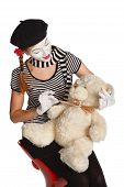 stock photo of clown rose  - Mime comedian playing with teddy bear isolated on white background - JPG