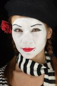 stock photo of clown rose  - Portrait of a young lady dressed up as a mime isolated over black background - JPG