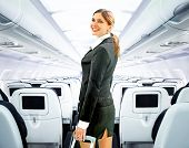 foto of flight attendant  - beautiful flight attendant on board of big plane - JPG