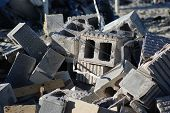 image of cinder block  - Cinder blocks and other refuse in a pile of material on a demolition site - JPG