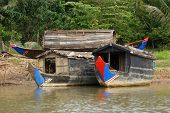 image of houseboats  - riparian scenery with houseboats at a river in Cambodia - JPG