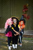 image of antichrist  - Portrait of three Halloween girls with broom - JPG
