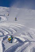stock photo of cannon  - snow cannon making snow at Livigno ski resort Italy - JPG