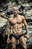 picture of early-man  - Hot Muscular Wet Man Wearing Tiny Black Underwear with Rocky Background - JPG